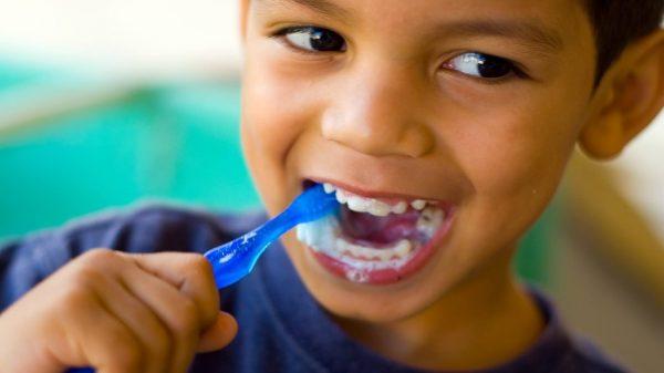 happy-young-boy-brushing-teeth