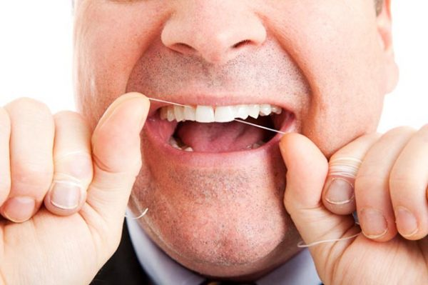 flossing-too-little-ruins-your-smile