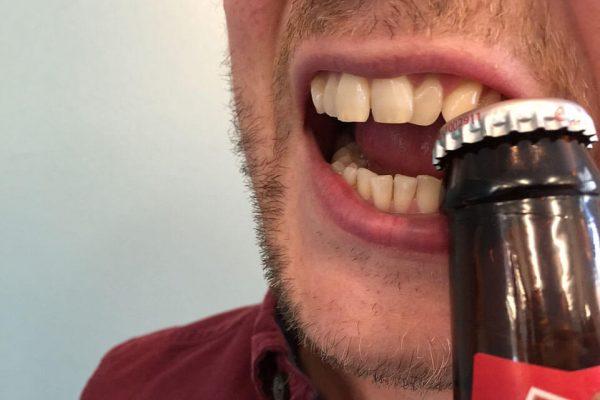 open-bottle-with-teeth