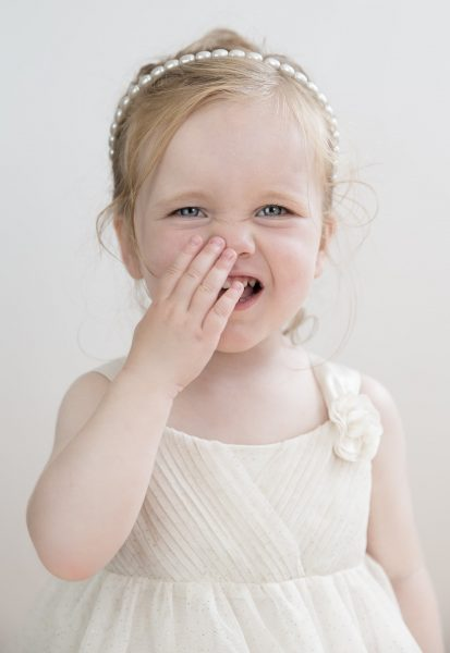 child-bad-breath-covering-mouth