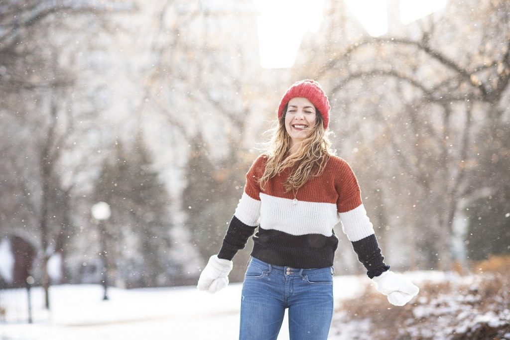 woman smiling in winter snow